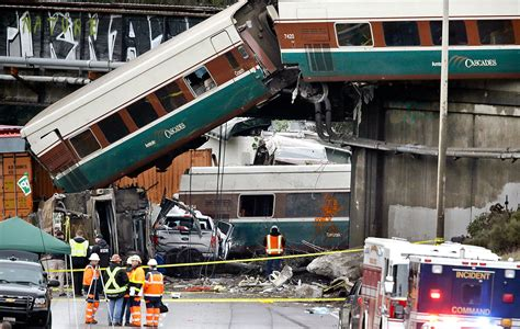 3 killed when train hurtles off I-5 overpass near DuPont